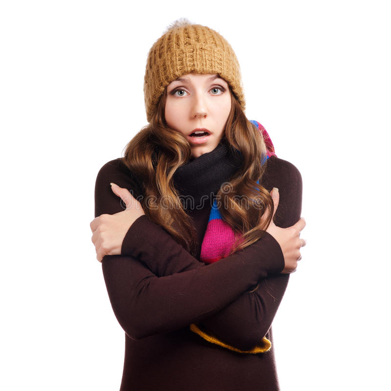 Überraschte schöne junge Frau kleidete mit Winterkleidung an lizenzfreies stockfoto