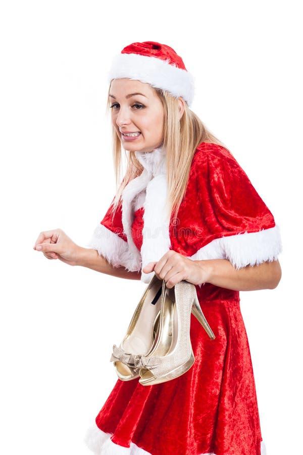 Überraschte Weihnachtsfrau mit Schuhen stockbild