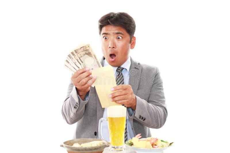 Überraschter asiatischer Geschäftsmann stockfotos