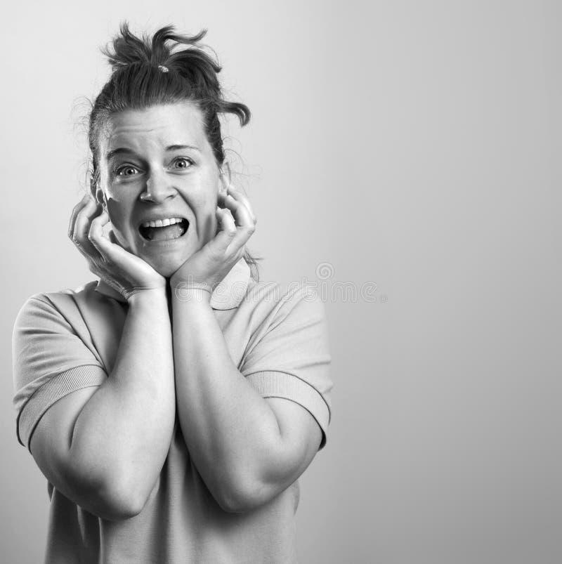 Überraschter Frauengesichtsausdruck stockfoto