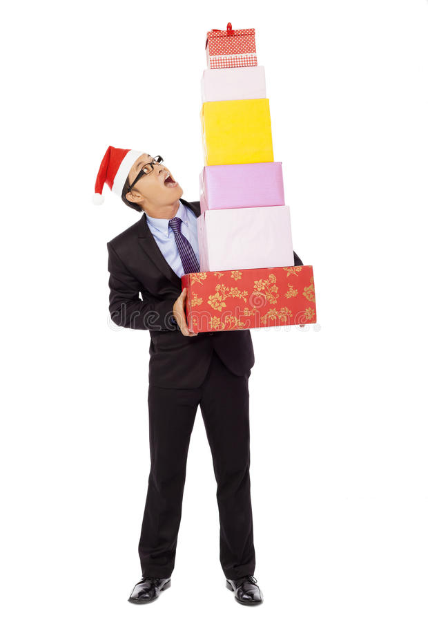 Überraschter Geschäftsmann, der Geschenkboxen hält Lokalisiert auf Weiß lizenzfreies stockfoto