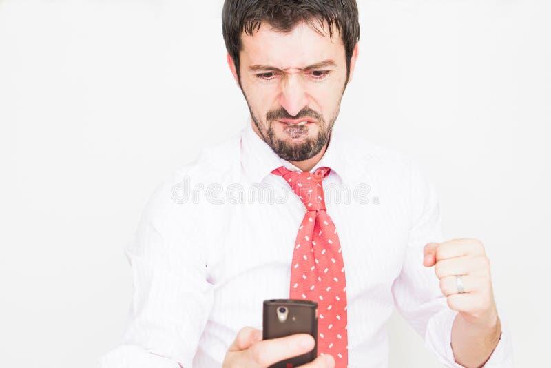 Geschäftsmann mit einem Telefon stockfotografie