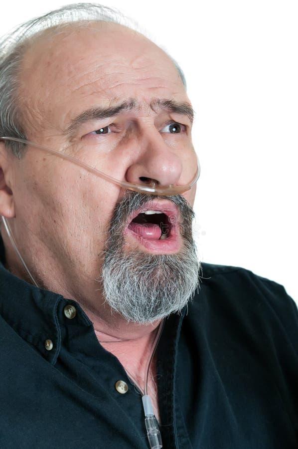 Überraschter Mann mit Atmungsunfähigkeit stockfotografie