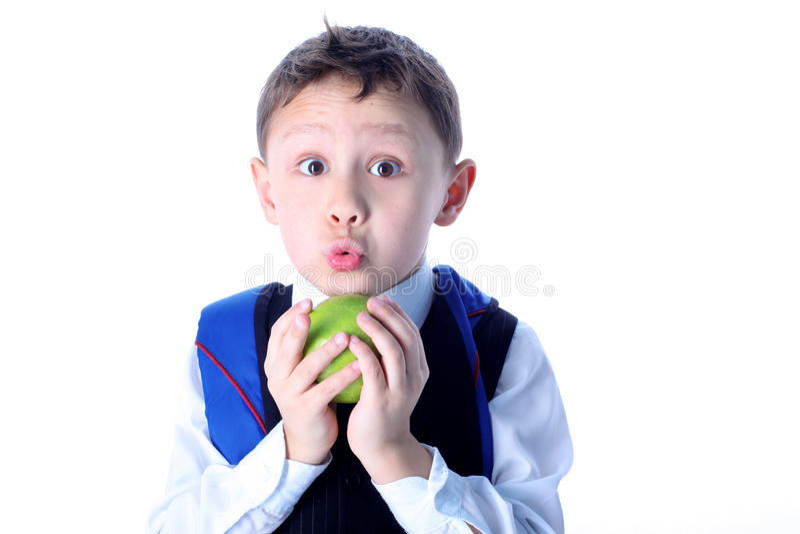 Überraschter Schüler mit Apfel lizenzfreies stockfoto