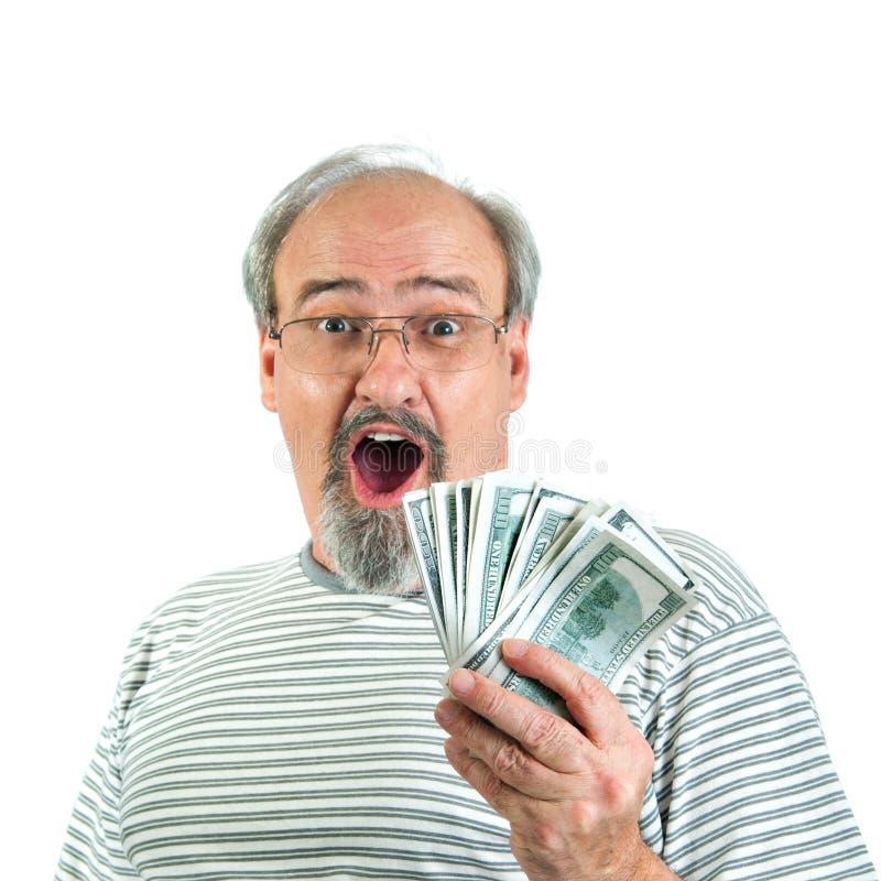 Überraschter Sieger des Bargeldes stockfoto