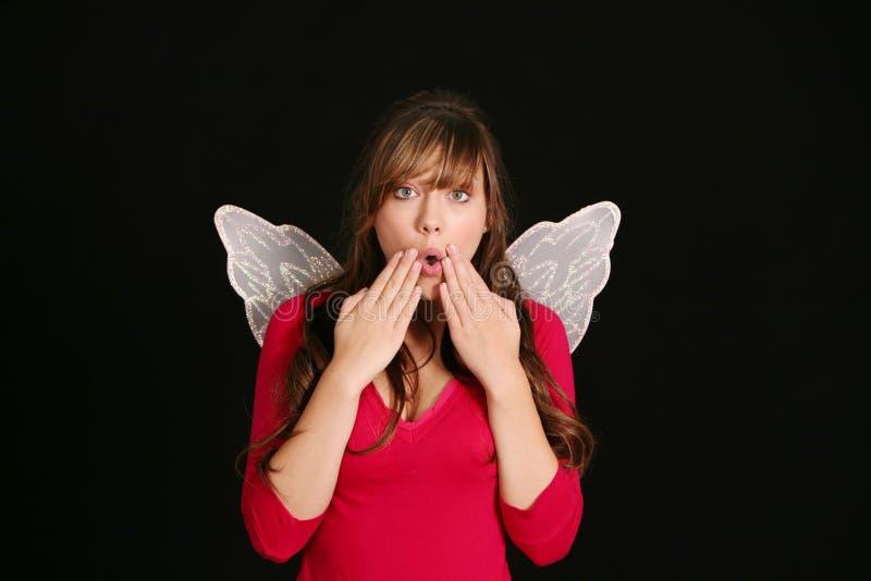 Überraschtes Mädchen in den feenhaften Flügeln lizenzfreie stockfotos