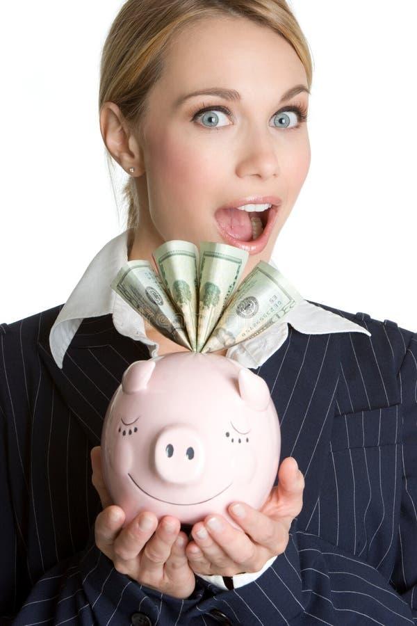 Überraschtes Piggybank Mädchen stockfoto