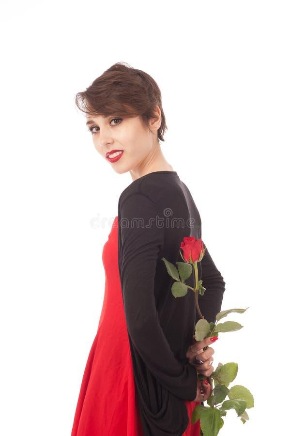 Überraschung mit einer Rose stockbild