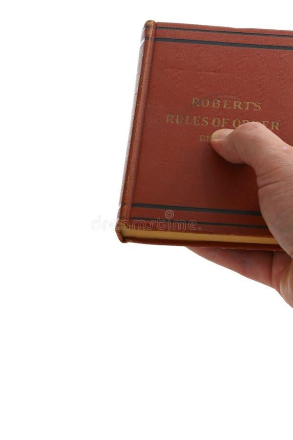 Überreichen eines Buches zu einem neuen Vorsitzenden stockfotos