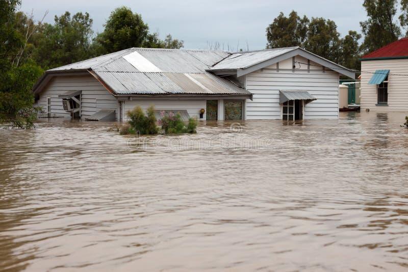 Überschwemmungsversicherung-Haus stockfotografie