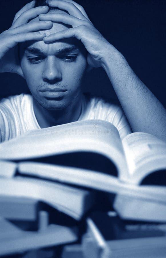 Überwältigt durch Homework stockfoto