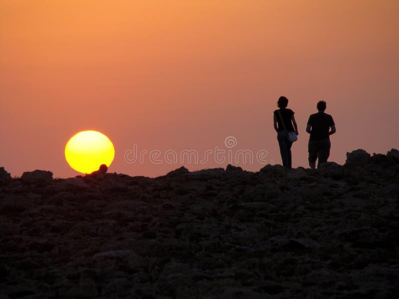 Überwachen des Sonnenuntergangs lizenzfreie stockfotos