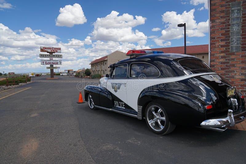 Überwachen Sie das Retro- Autofoto polizeilich, das auf die Straße zu Grand Canyon gemacht wird lizenzfreies stockfoto