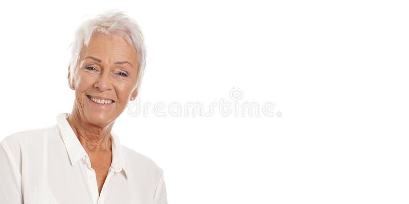 Überzeugte reife Frauenfahne stockbild