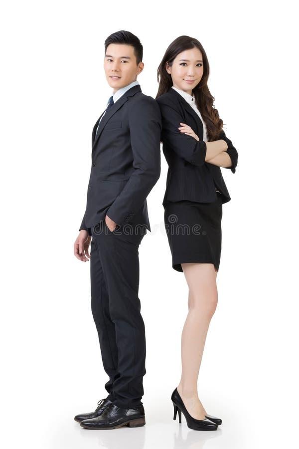 Überzeugter asiatischer Geschäftsmann und Frau lizenzfreie stockbilder