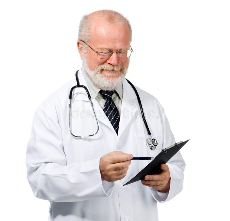 Überzeugter Doktor mit Gesundheitsakte lizenzfreies stockfoto