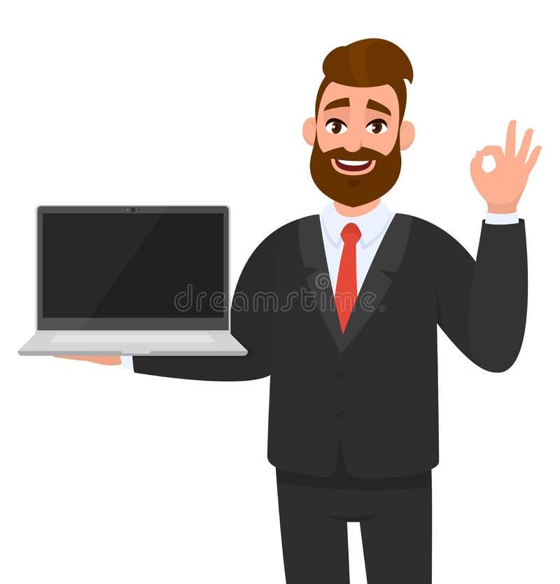 Überzeugter Geschäftsmann, der eine neue Marke, eine Laptop-Computer des leeren Bildschirms und ein Gestikulieren, machend okay,  lizenzfreie abbildung