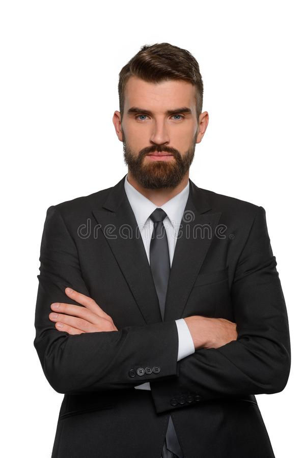 Überzeugter Geschäftsmann mit ernstem Gesicht lizenzfreies stockbild
