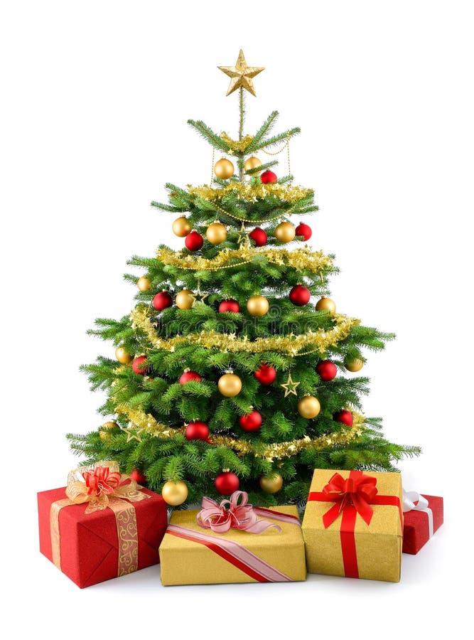 Üppiger Weihnachtsbaum mit Geschenkboxen lizenzfreie stockfotografie