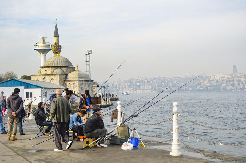 Üsküdar Shamsi Pasha Mosque is seen in the background. Istanbul at the Bosphorus bonito, bluefish, mackerel, sardines, sea bass stock photography