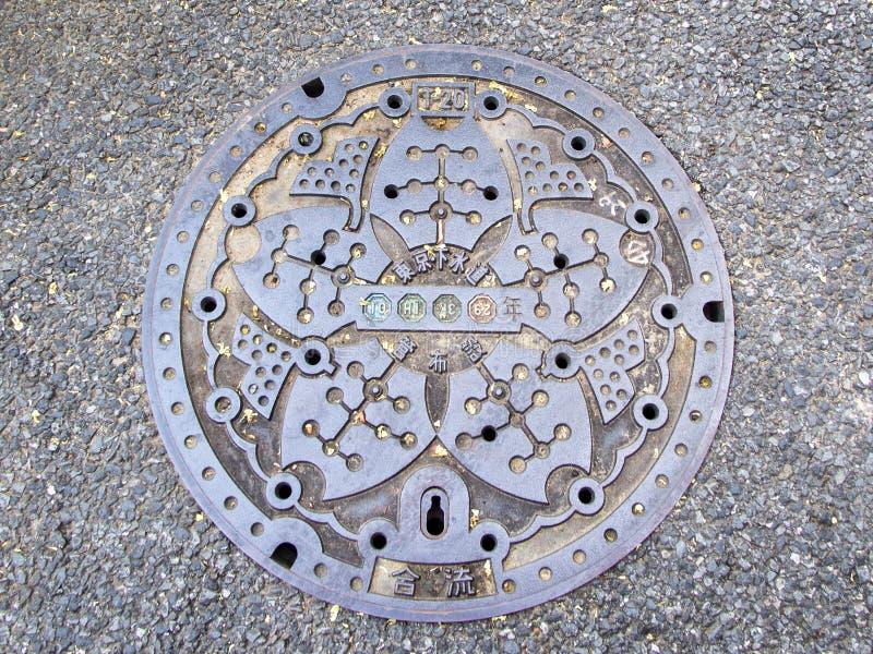 Łącząca kanalizaci manhole pokrywa, Minato oddział, Tokio zdjęcie royalty free
