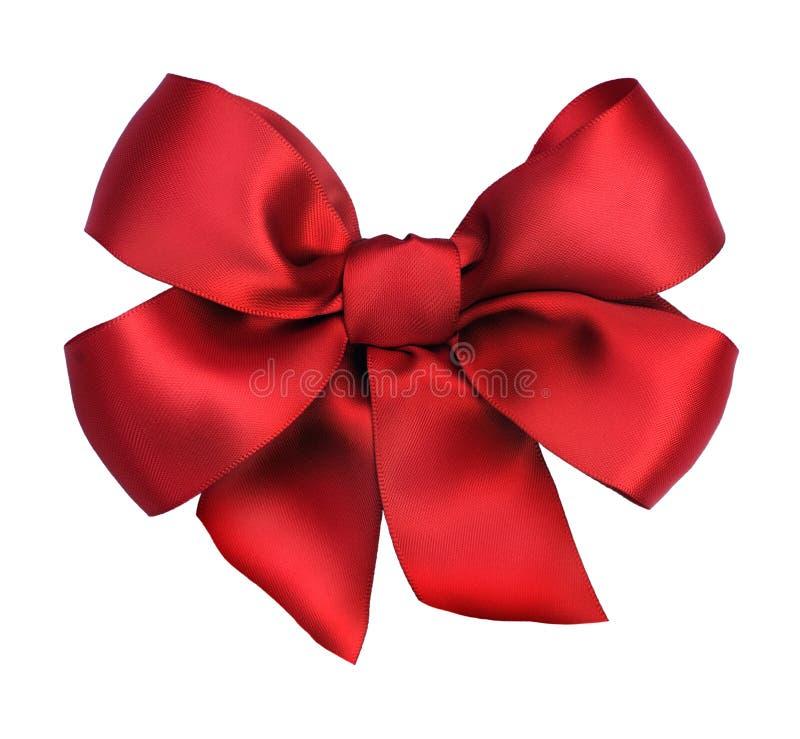 łęku prezenta czerwony tasiemkowy atłas zdjęcia royalty free