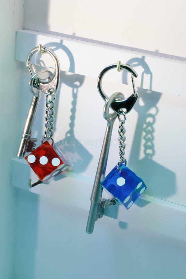 łańcuchów kostka do gry klucz obrazy stock
