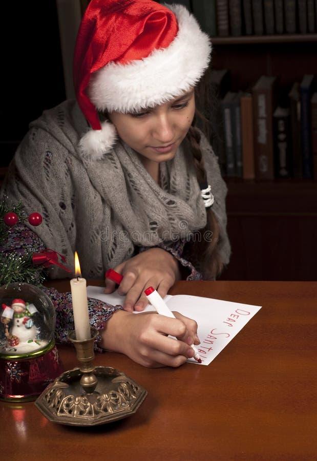 Ładna blondyn dziewczyna z Santa kapeluszem zdjęcie stock