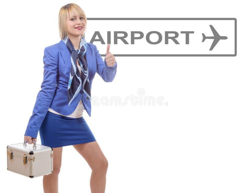 Ładna blondynki stewardesa w błękitnym kostiumu z małą walizką zdjęcia royalty free