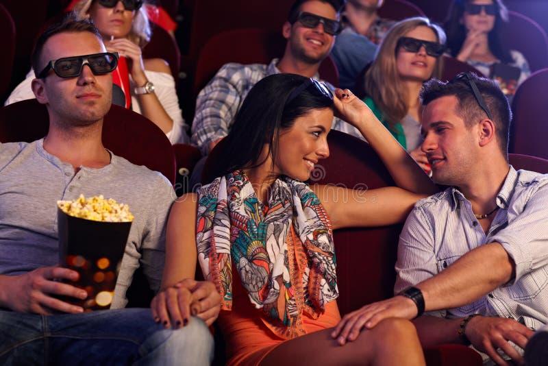 Ładna dziewczyna flirtuje w kinie obraz royalty free