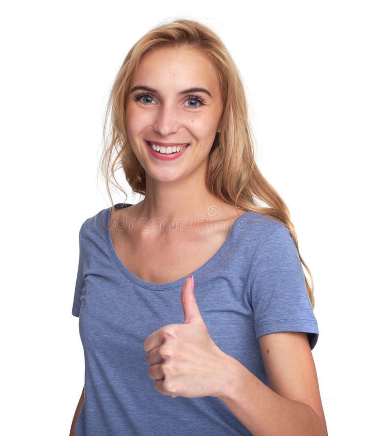 Ładna dziewczyna uśmiecha się aprobaty i pokazuje zdjęcia stock