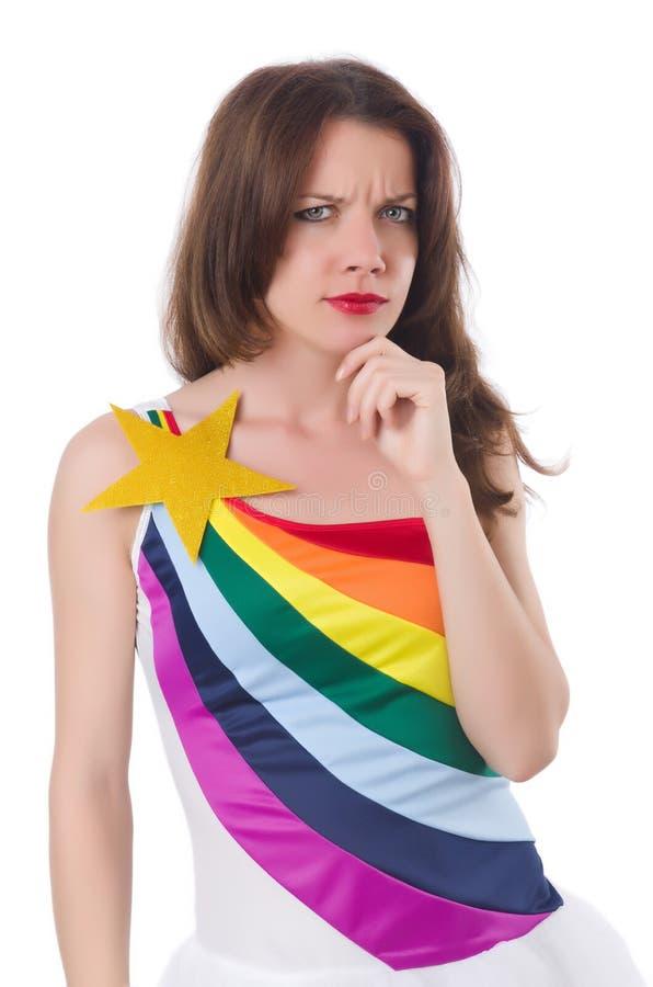 Ładna dziewczyna w kolorowej sukni odizolowywającej na bielu zdjęcia stock