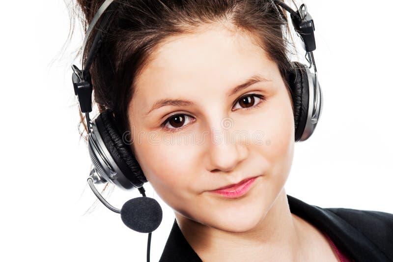 Ładna dziewczyna z słuchawki. obraz stock