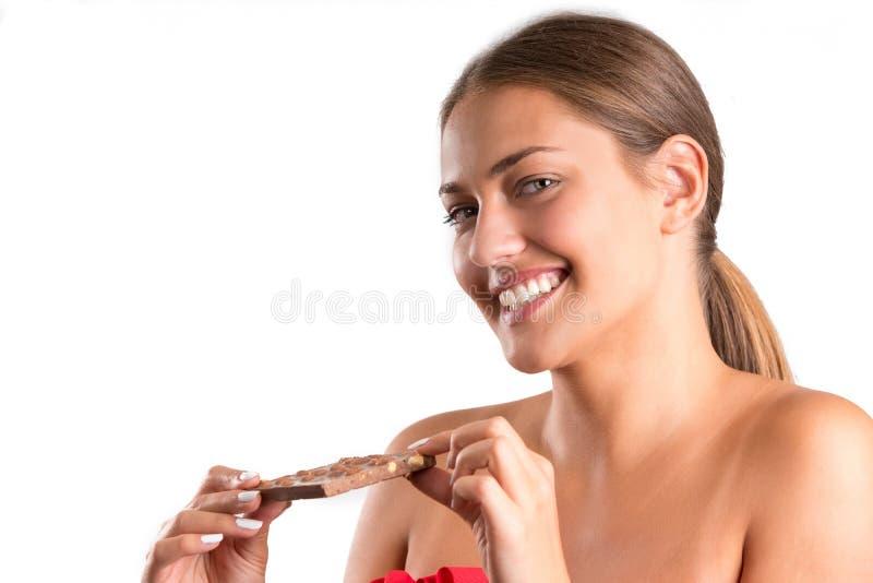 Ładna dziewczyny łasowania czekolada odosobniony zdjęcia royalty free
