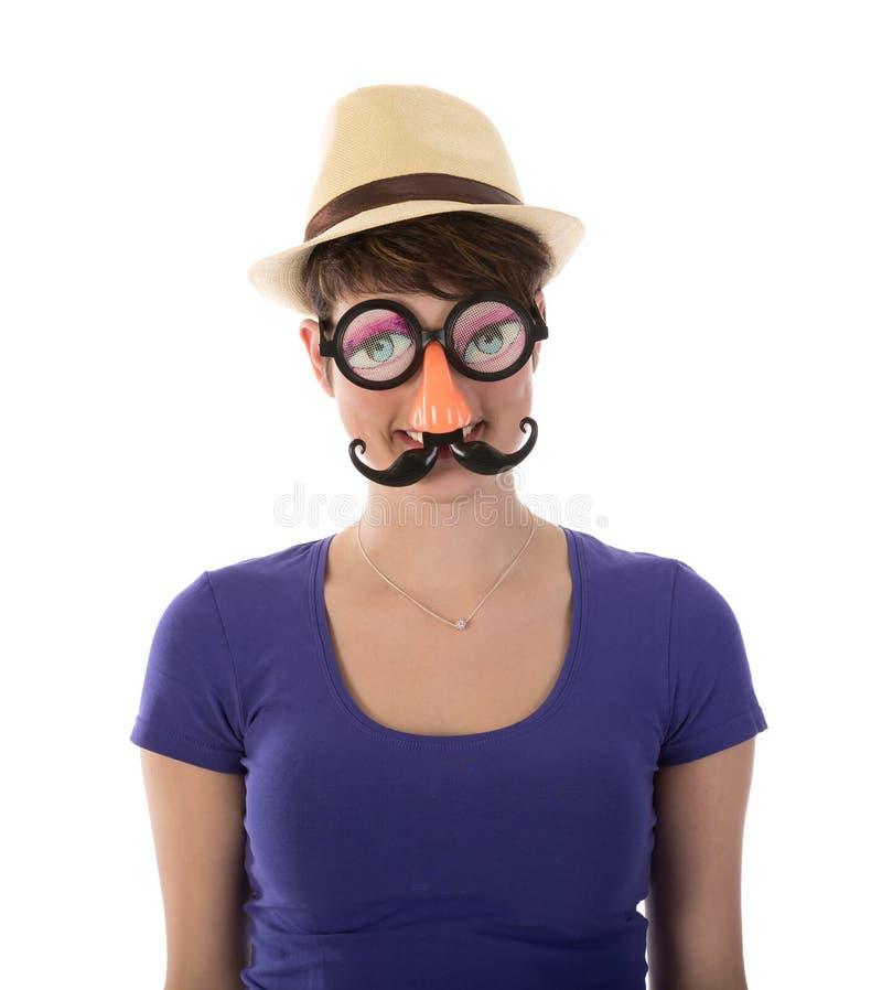 Ładna kobieta z śmieszną maską i kapeluszem obraz royalty free