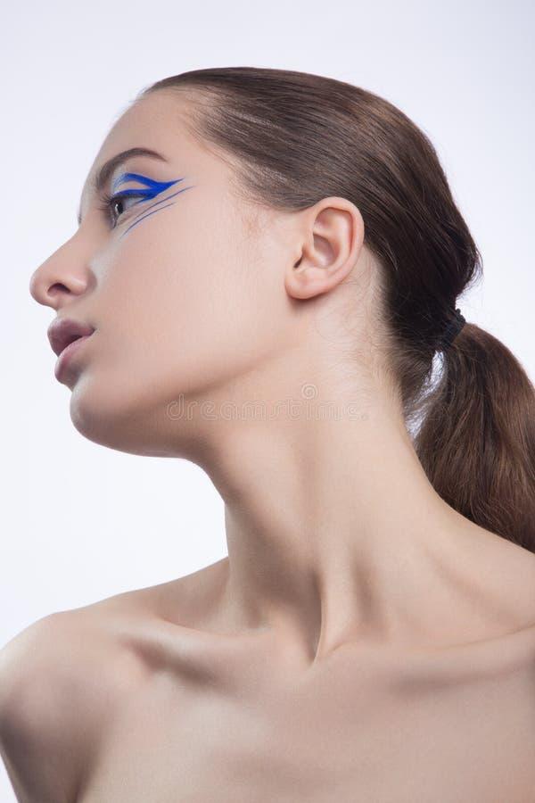 Ładna kobieta z perfecr skórą i niebieskie linie na oka creatime m fotografia stock