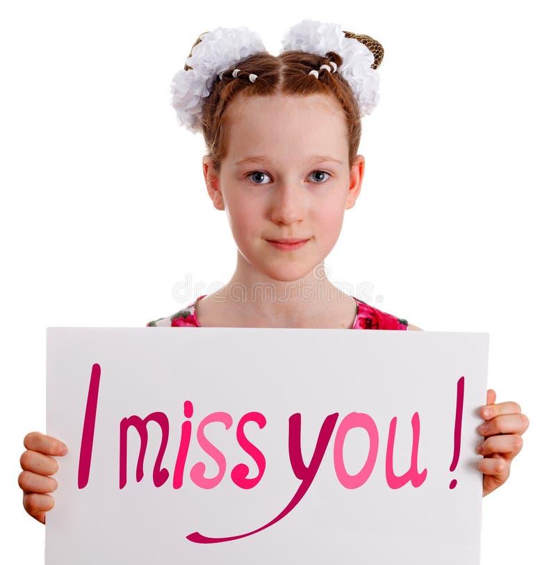 Ładna młoda śliczna dzieciak dziewczyny mienia deska z tekstem obrazy royalty free