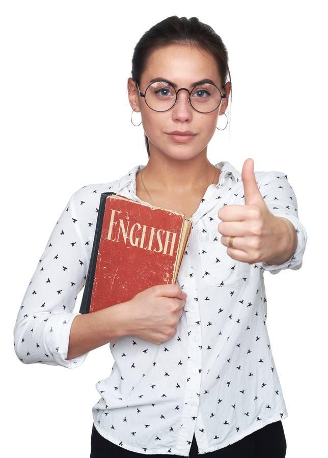 Ładna młoda dziewczyna trzyma Angielską książkę zdjęcie stock
