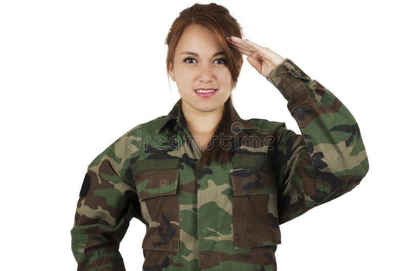 Ładna młoda dziewczyna ubierająca w zielonym wojskowym fotografia stock