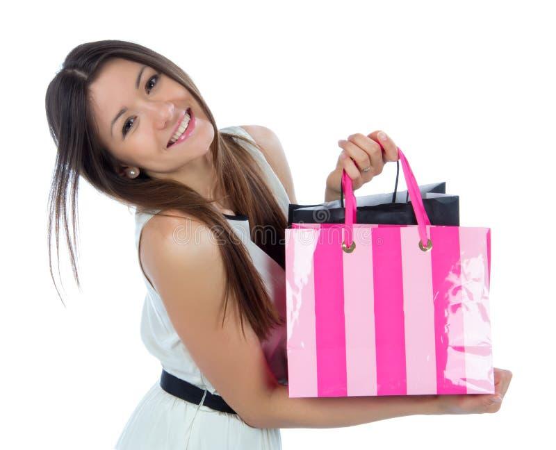 Ładna młoda kobieta z torba na zakupy po pomyślnego zakupy obrazy royalty free