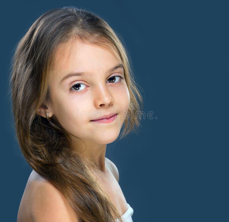 Ładna mała dziewczynka odizolowywająca fotografia stock
