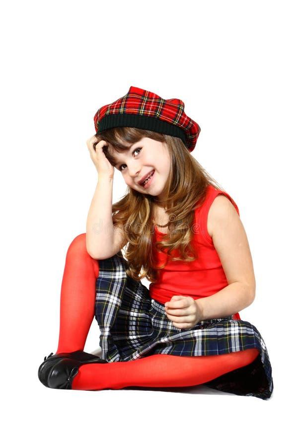 Siedząca dziewczyna w czerwieni obrazy royalty free