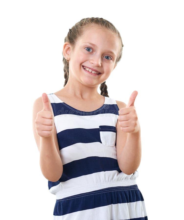 Ładna mała dziewczynka w pasiastym smokingowym pracownianym portrecie, pokazuje najlepszy gest, biały tło obrazy stock
