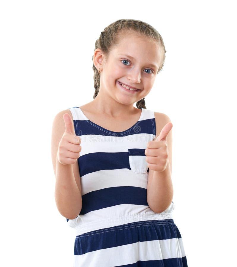 Ładna mała dziewczynka w pasiastym smokingowym pracownianym portrecie, pokazuje najlepszy gest, biały tło fotografia stock