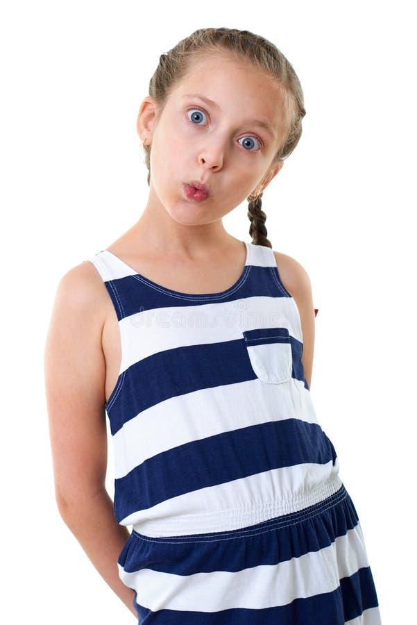 Ładna mała dziewczynka w pasiastym smokingowym pracownianym portrecie, robi zdziwionej twarzy, biały tło zdjęcia royalty free