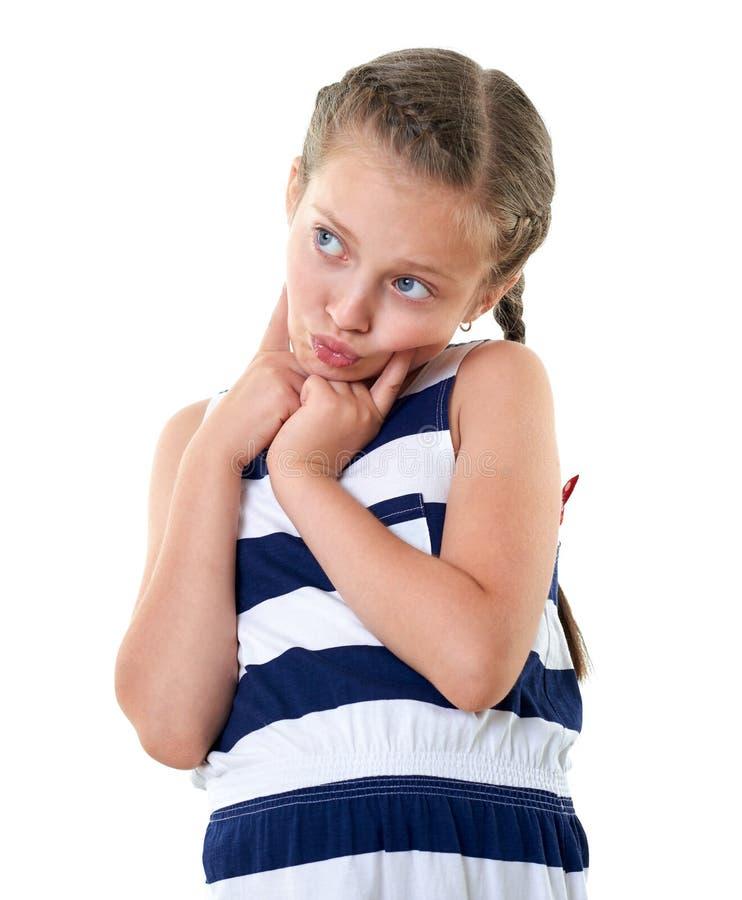 Ładna mała dziewczynka w pasiastym smokingowym pracownianym portrecie, robi zdziwionej twarzy, biały tło obrazy stock