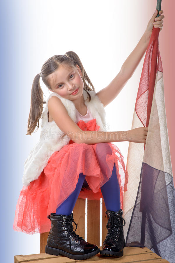Ładna mała dziewczynka z francuską flaga zdjęcia royalty free