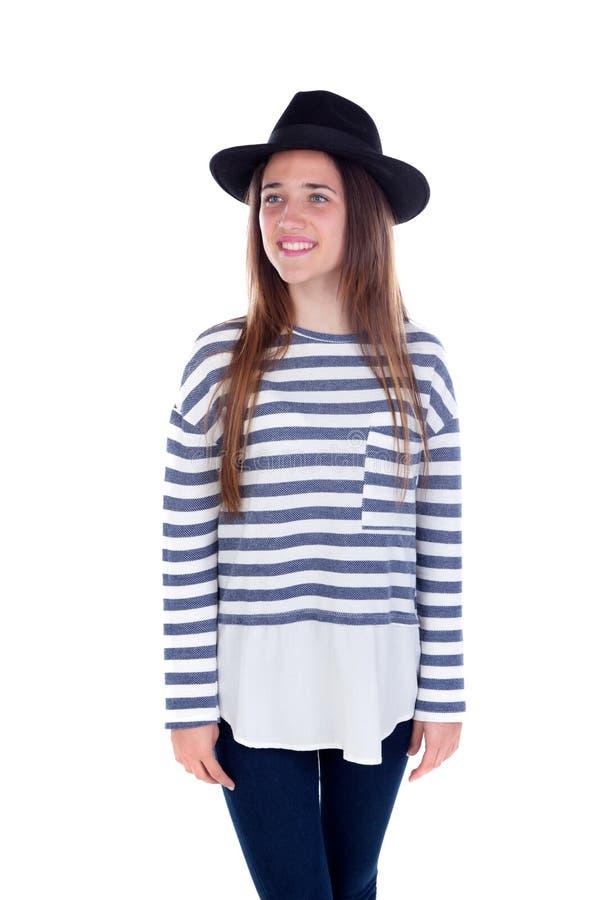 Ładna nastolatek dziewczyna z czarnym kapeluszem pozuje przy studiiem zdjęcie royalty free