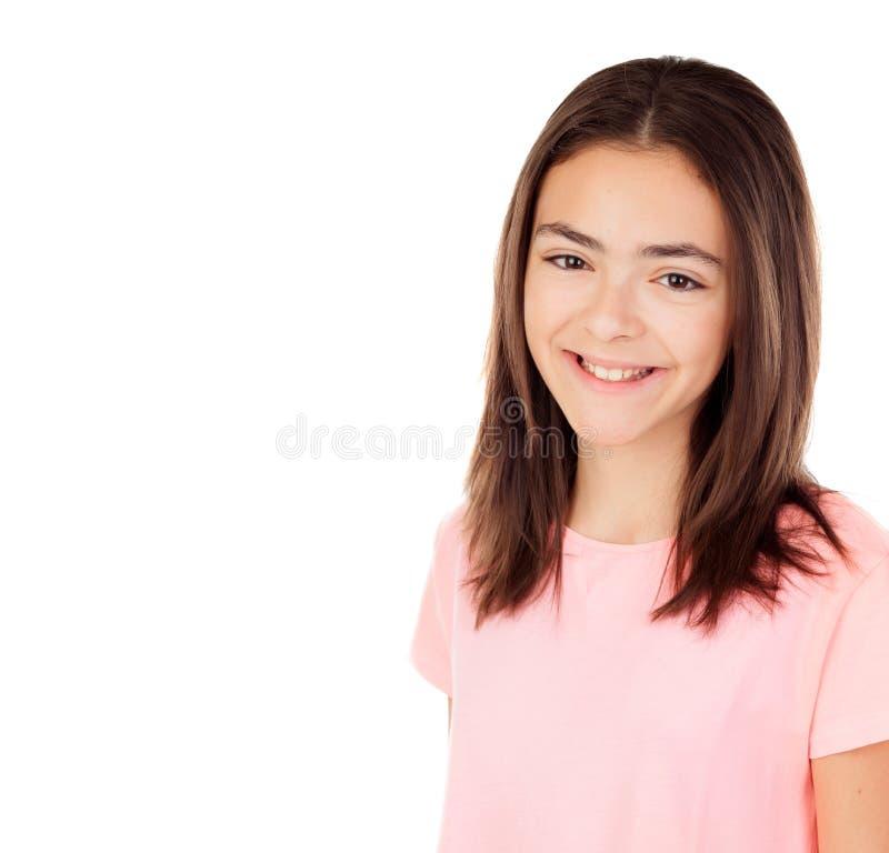 Ładna preteenager dziewczyna z różową koszulką fotografia stock