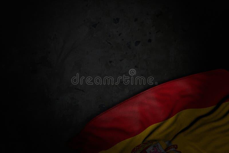 Ładny jakaś uczty flagi 3d ilustracja - ciemna fotografia Hiszpania flaga z dużymi fałdami na czerń kamieniu z pustym miejscem dl ilustracja wektor